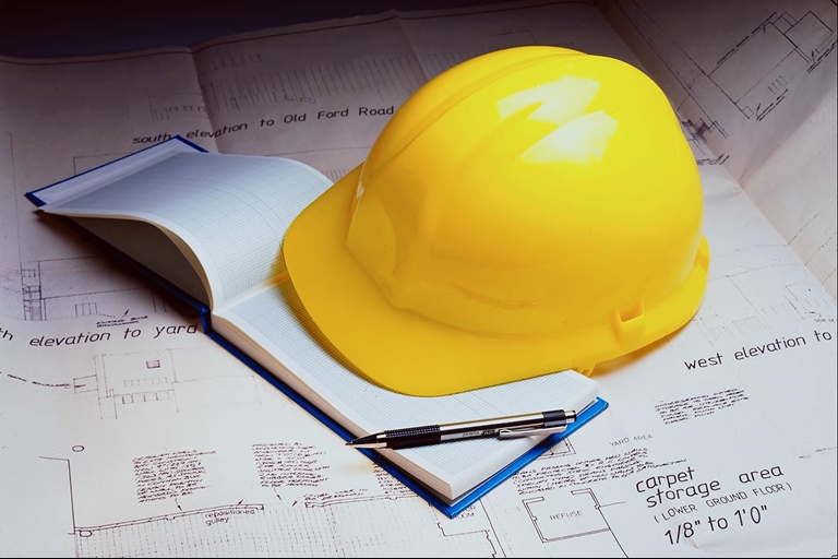 Picture of hard hat and plans